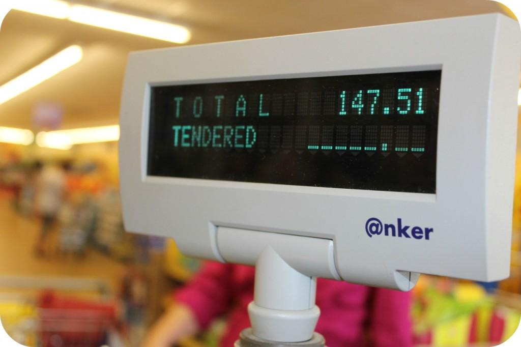 Precio total del viaje de compras en la caja registradora.